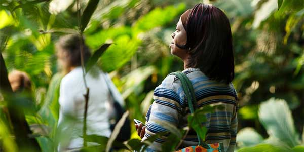 Woman looking inspired in the Rainforest Biome